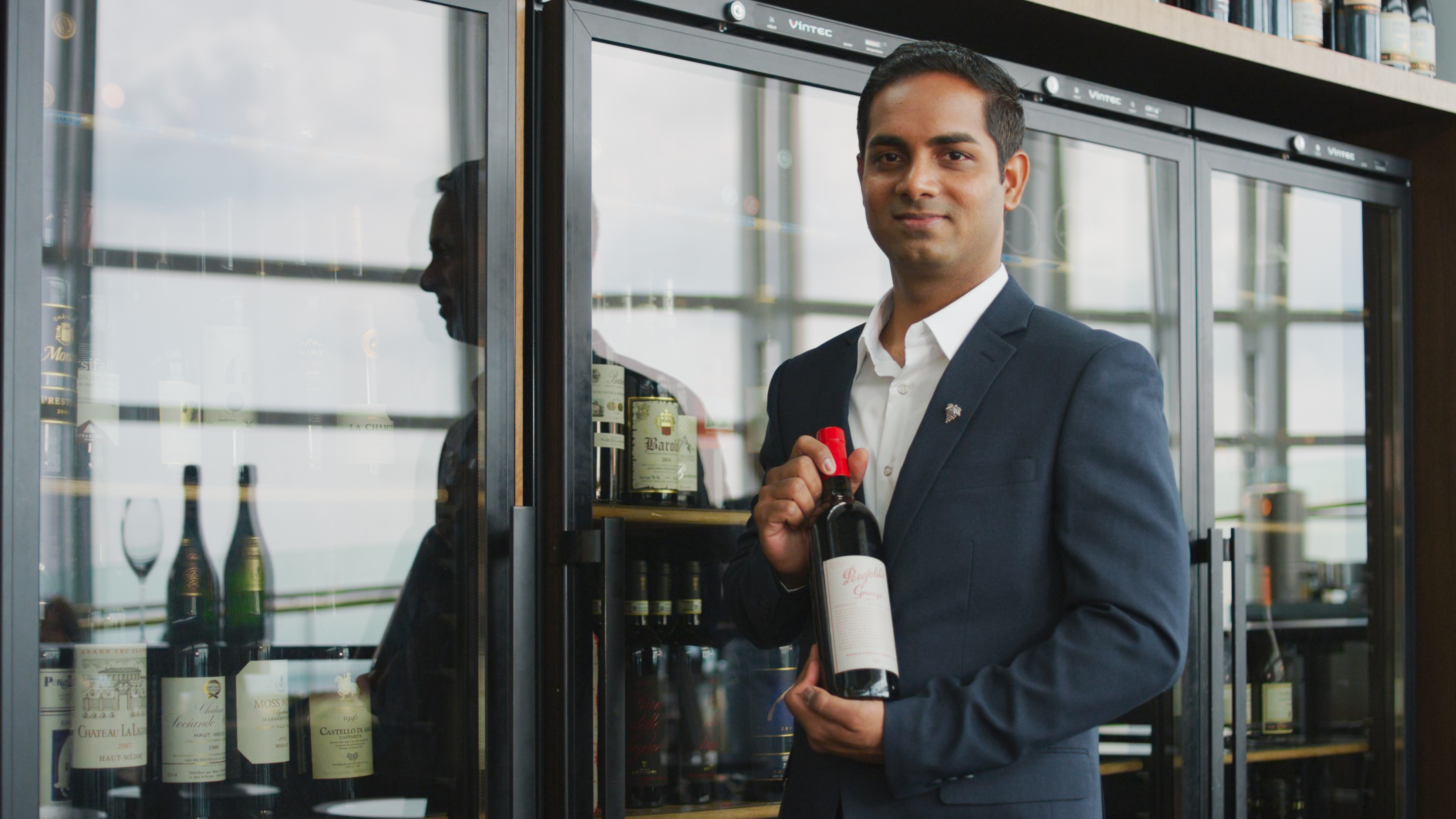 Panneer Selvam, Head Sommelier at Salt Grill & Sky Bar, with Vintec Wine Cabinets